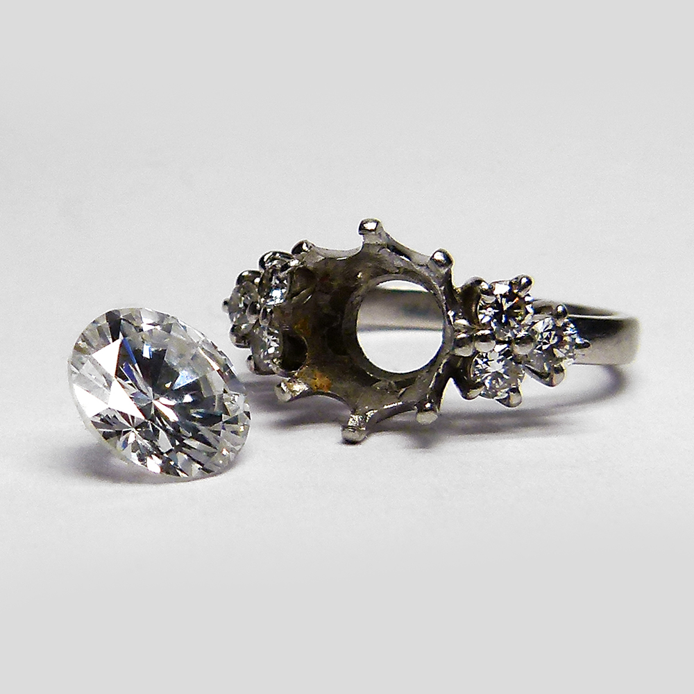 Motley old ring with diamond removed