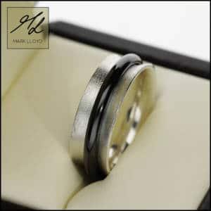 mark lloyd silver and black zirconium spinner ring